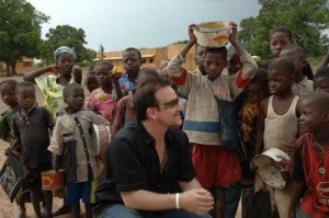 Bono, hard at work making us feel better about ourselves